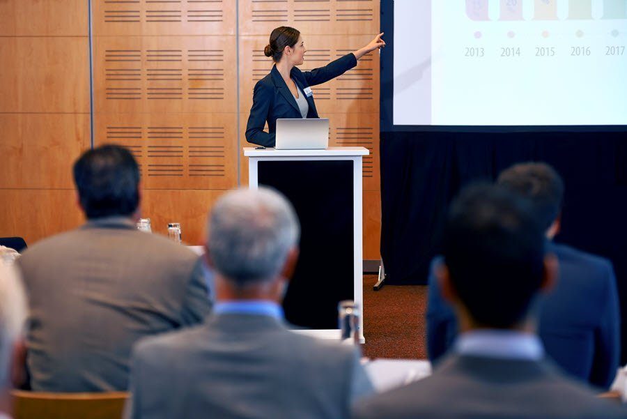 woman using webcast platform as learning management system